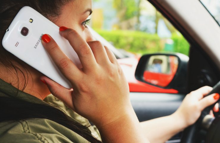 person woman smartphone car