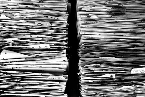 stacks of papers to file when dealing with insurance companies